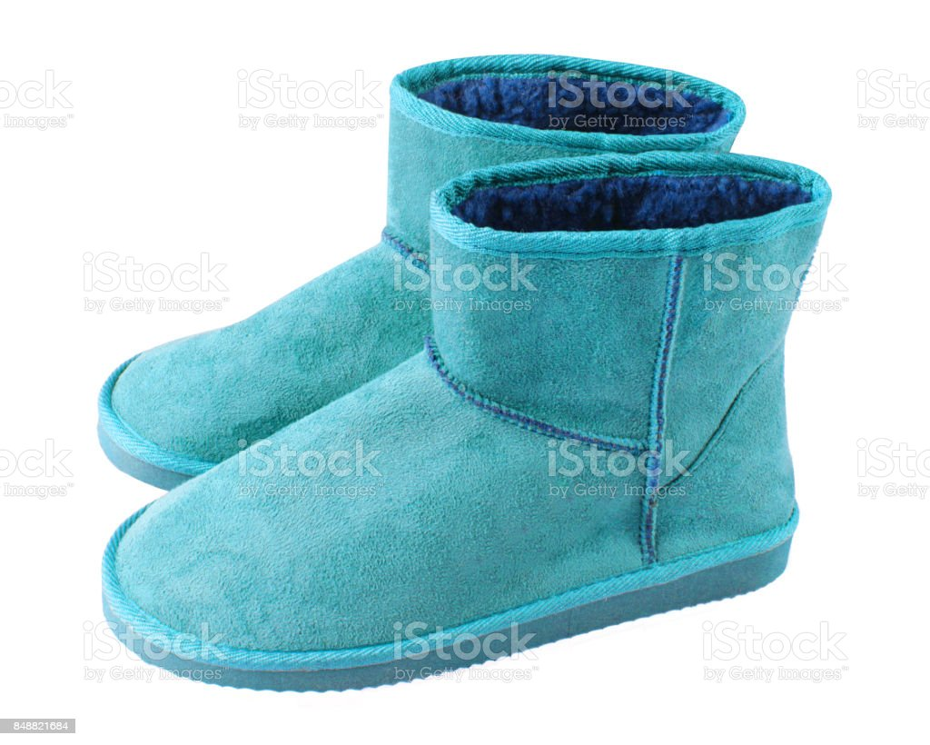 Cyan light blue pair of short winter ugg boots isolated white royalty-free stock photo