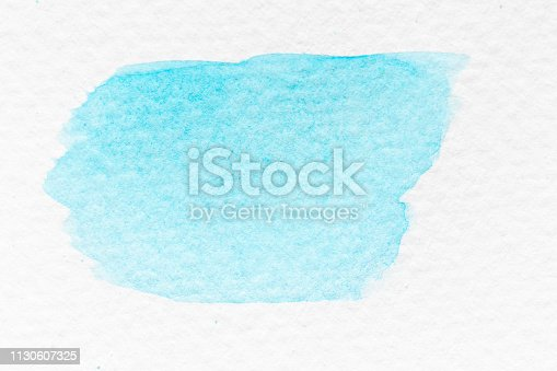 847999586 istock photo Cyan or light blue color watercolor handdrawing as brush or banner on white paper background 1130607325