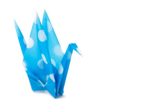 Cyan origami crane stock photo