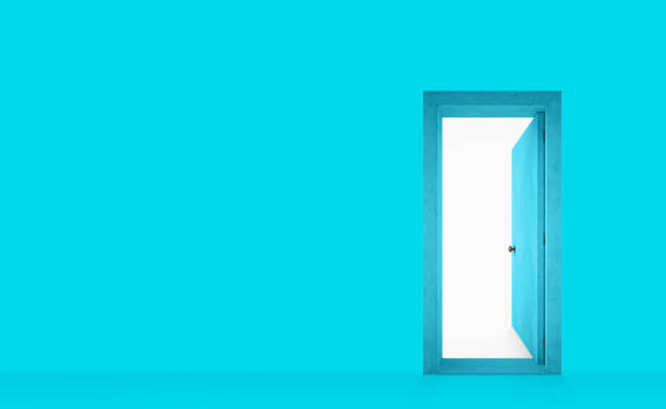 Cyan painted wall with an open door on the right stock photo