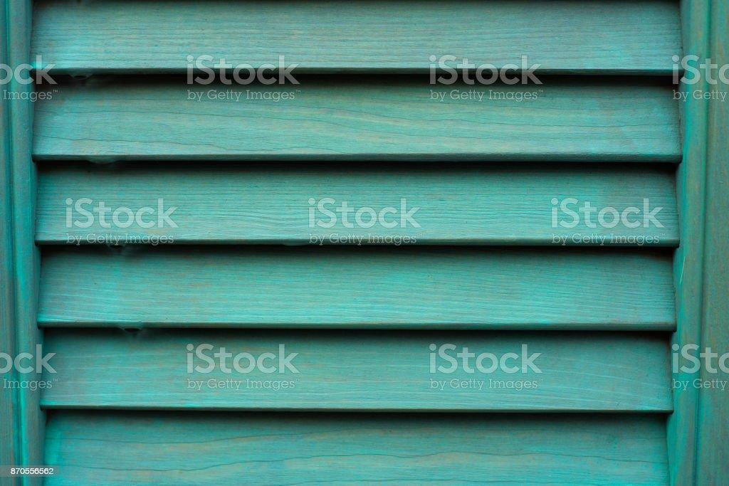 Cyan window with wooden shutter. stock photo