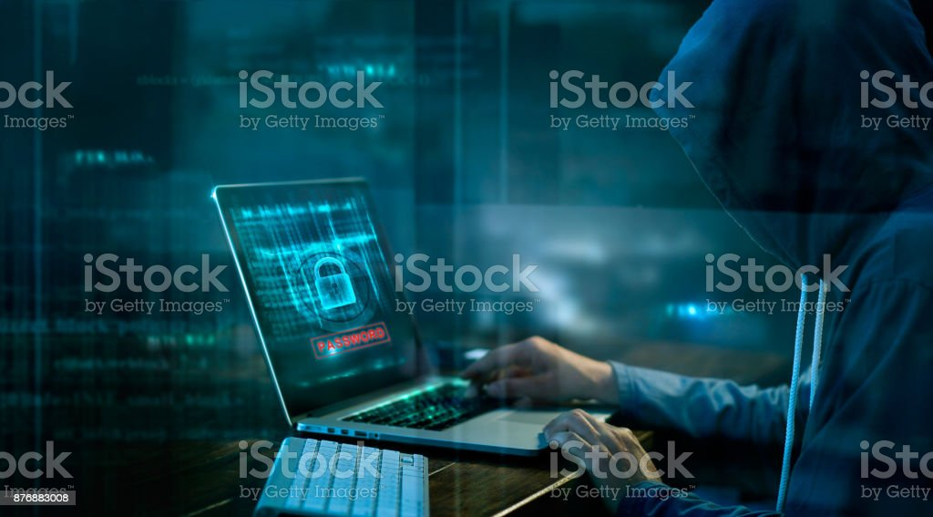 Cyber attack or computer crime hacking password on a dark background. stock photo