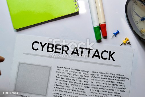 Cyber Attack text in headline isolated on white background. Newspaper concept