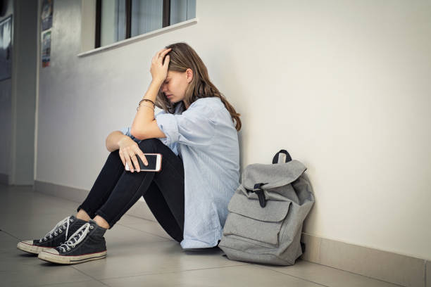 Cyber bullying at high school stock photo