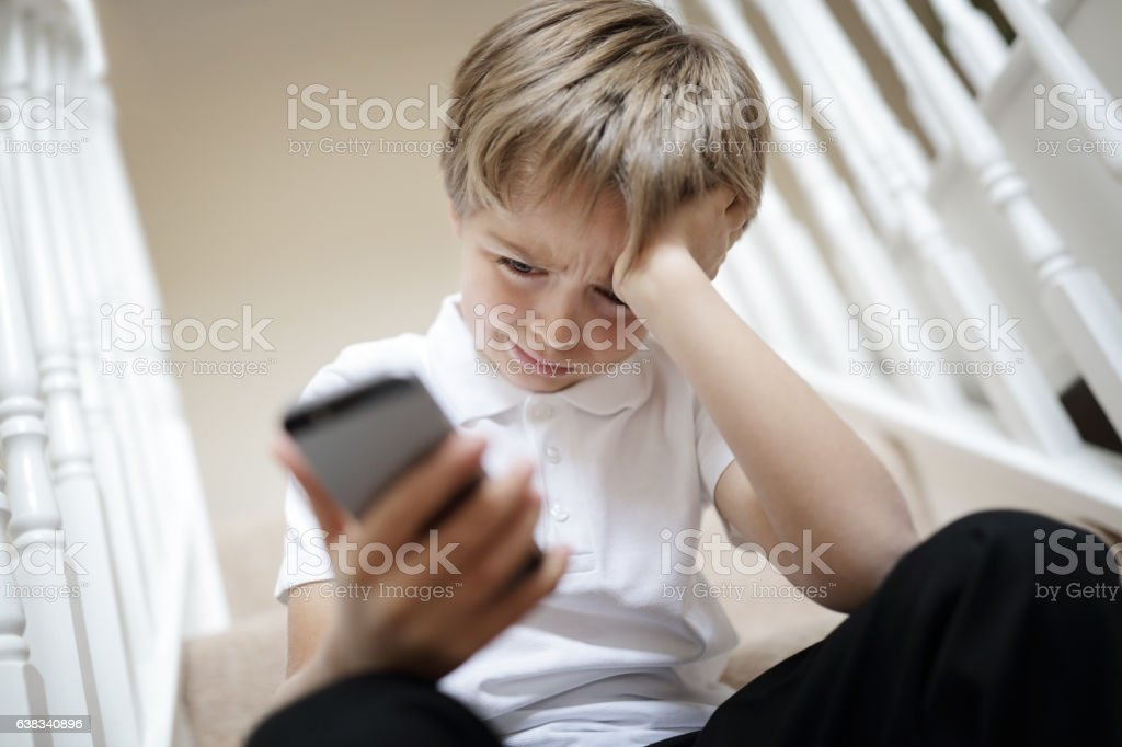 Cyber bullying by phone text message stock photo
