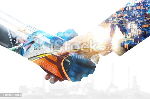 istock Cyber communication and robotic trend and artificial intelligence, autonomous car concepts. Industrial 4.0 Cyber Physical Systems concept. Robot and Engineer human holding hand with handshake. 1139529983