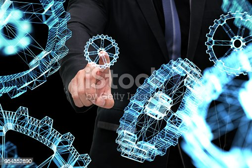 istock Cyber communication and robotic trend , Industrial 4.0 Cyber Physical Systems technology concept. ฺฺBusiness man point finger and 3d rendering gears on black background. 954352890
