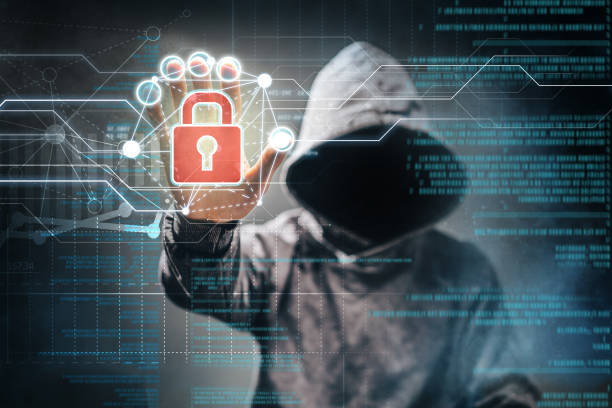 Cyber crime Male hacker accessing to personal information. Hooded man with obscure face touching digital panel with mixed media and binary code. Technologal, virtual crime, cybersecurity concept. pirate criminal stock pictures, royalty-free photos & images