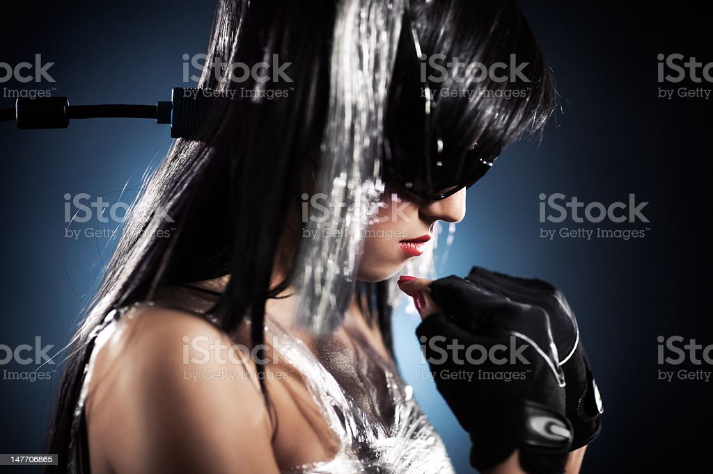 Cyber girl with cable connected to head royalty-free stock photo