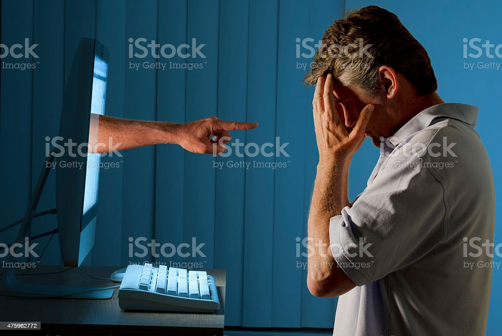 Cyber internet computer bullying and social media stalking stock photo