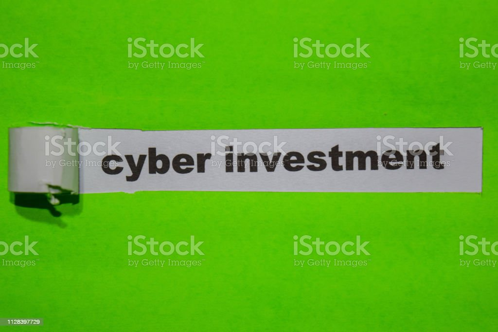 Cyber Investment, Inspiration and business concept on green torn paper stock photo