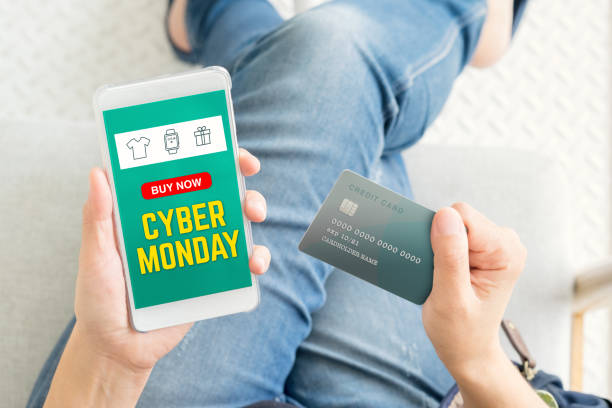 cyber monday sale using credit card to buy with promo code,top view close up woman hand shopping online with mobile app,digital marketing concept - cyber monday zdjęcia i obrazy z banku zdjęć