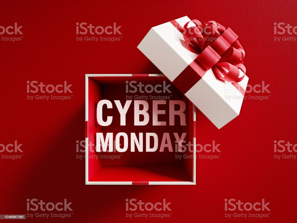 Cyber Monday Text Coming Out Of A White Gift Box Tied With Red Ribbon stock photo