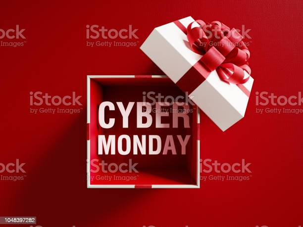 Cyber Monday Text Coming Out Of A White Gift Box Tied With Red Ribbon — стоковые фотографии и другие картинки Без людей