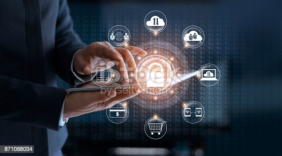 istock Cyber Security. Businessman using tablet technology and icon customer network connection and exchange data on the virtual display. Cyber attack concept 871068034