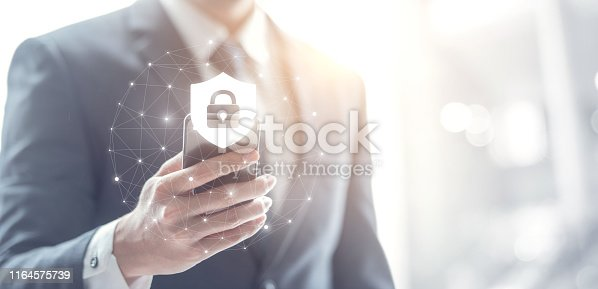 istock Cyber security concept, Businessman hand using smartphone with lock icon,  protection network and internet. 1164575739