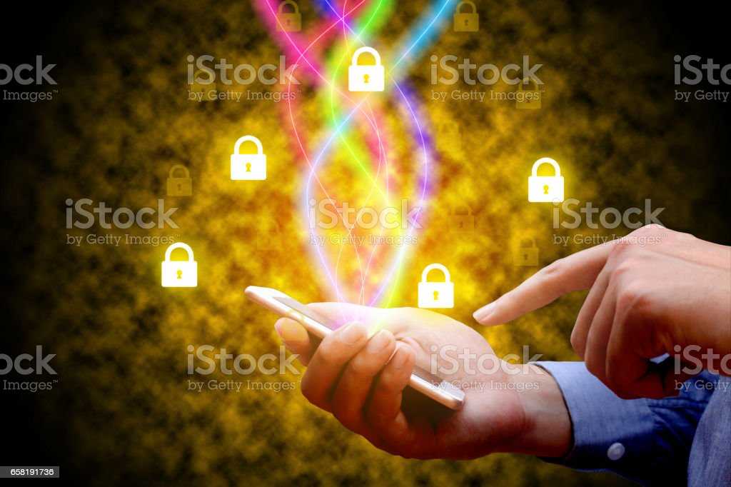 Cyber security concept. Businessman using smartphone and lock network icon. stock photo