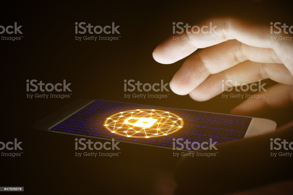 Cyber security concept, woman hand using and protection network. stock photo