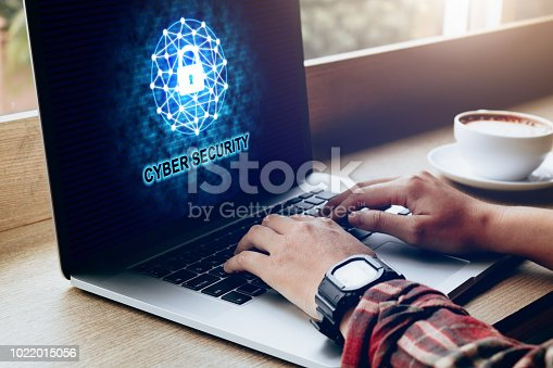 istock Cyber security data privacy concept with human using laptop at coffee cafe. 1022015056