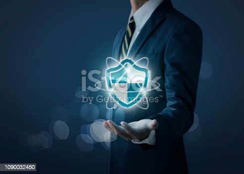 istock Cyber security, internet security or information protection service concept. Businessman is holding a cyber security icon on dark tone background. 1090032450