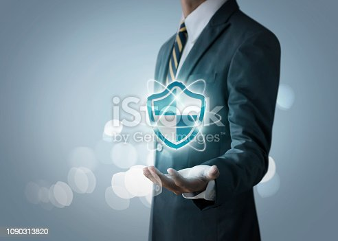istock Cyber security, internet security or information protection service concept. Businessman is holding a cyber security icon on bright tone background. 1090313820