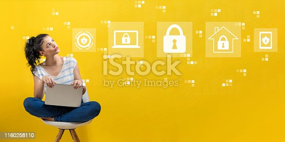 istock Cyber security with woman using a laptop 1160258110