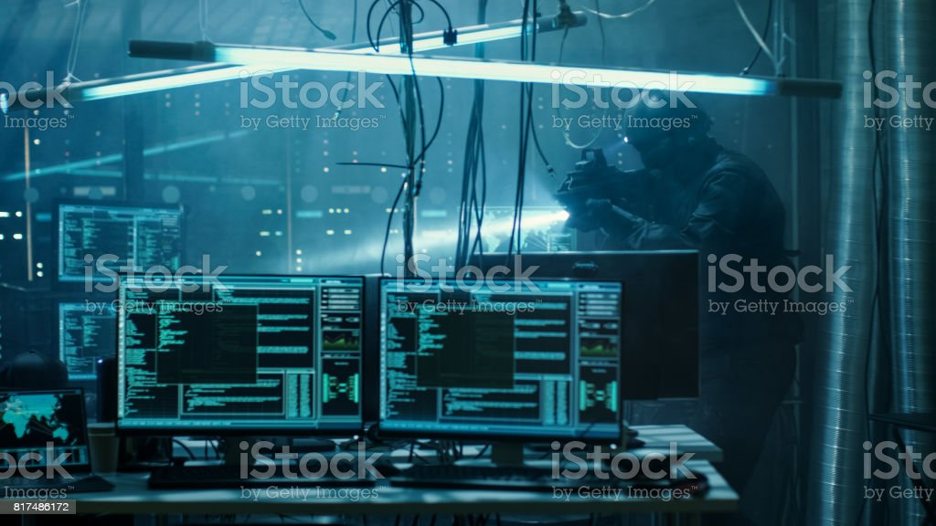 Cyber War Special Forces Fully Armed Soldier Uncovers Internationally Wanted Hacker's Hideout Place. Lair is Full of Monitors, Cables and Has Neon Lights. stock photo