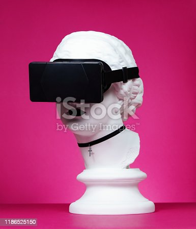 Plaster head model (mass produced replica of Head of Aphrodite of Knidos) with virtual reality headset and choker