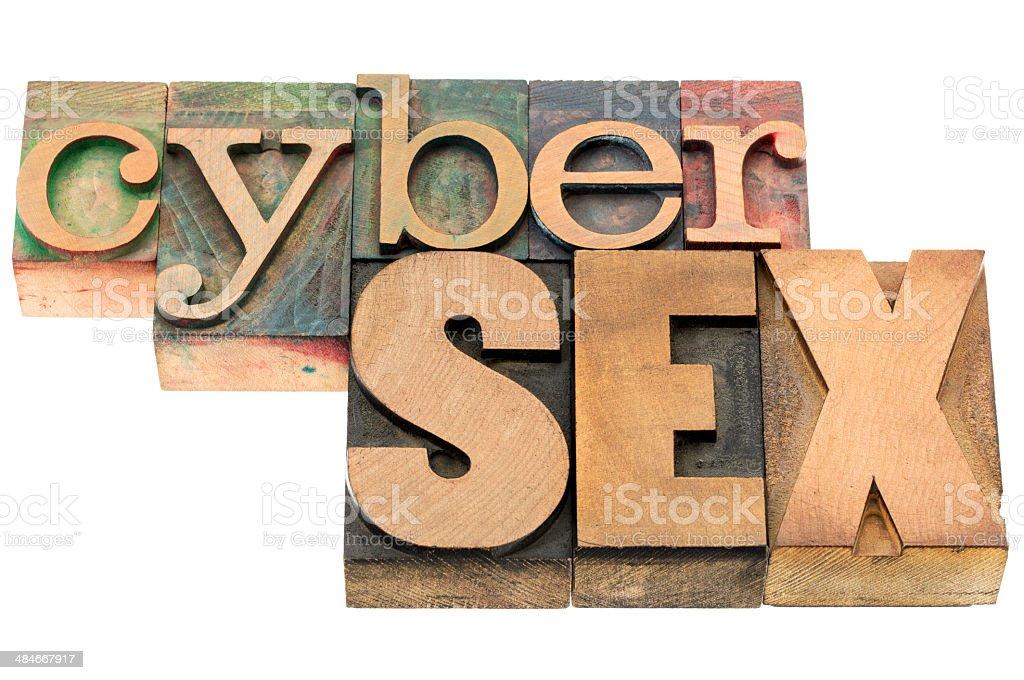 cybersex word in wood type stock photo