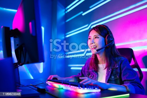 Young Asian Pretty Pro Gamer having live stream and playing in Online Video Game