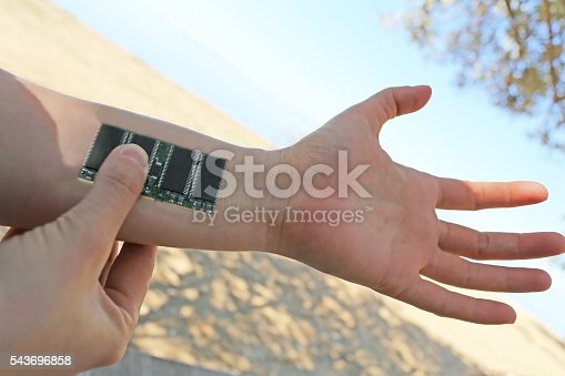 istock Cyborg arm with electronical circuit 543696858