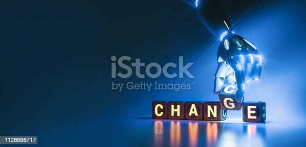 istock cyborg robot hand changes text cube - ai concept 1128698717