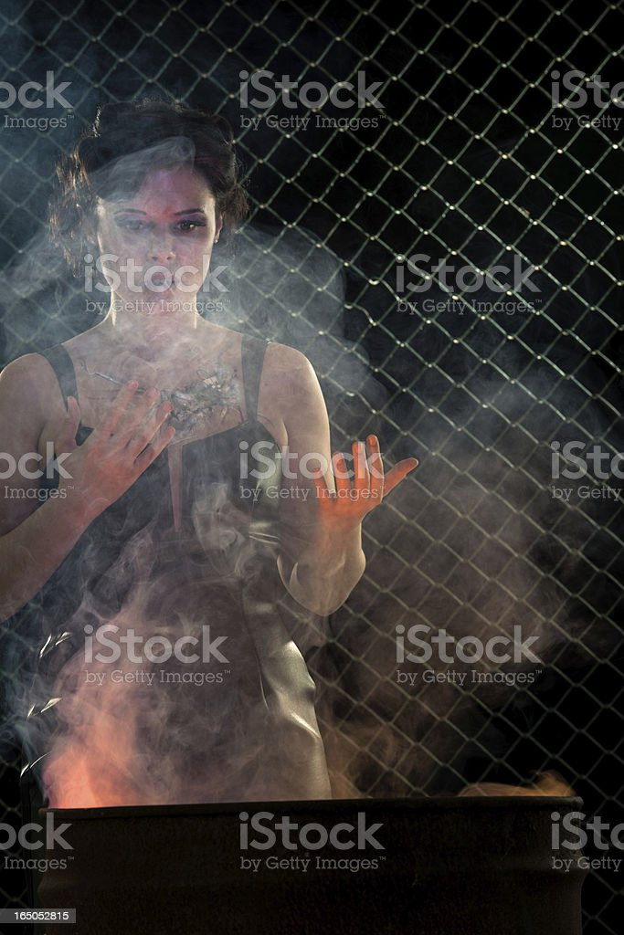 Cyborg Women Warming By Burn Barrel stock photo
