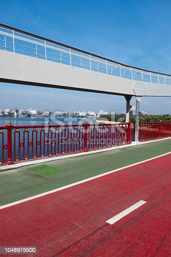 Cycle path on a pedestrian bridge across the Dnieper River. Kyiv. Ukraine