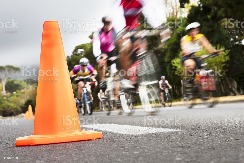 Cycle race with traffic cone royalty-free stock photo