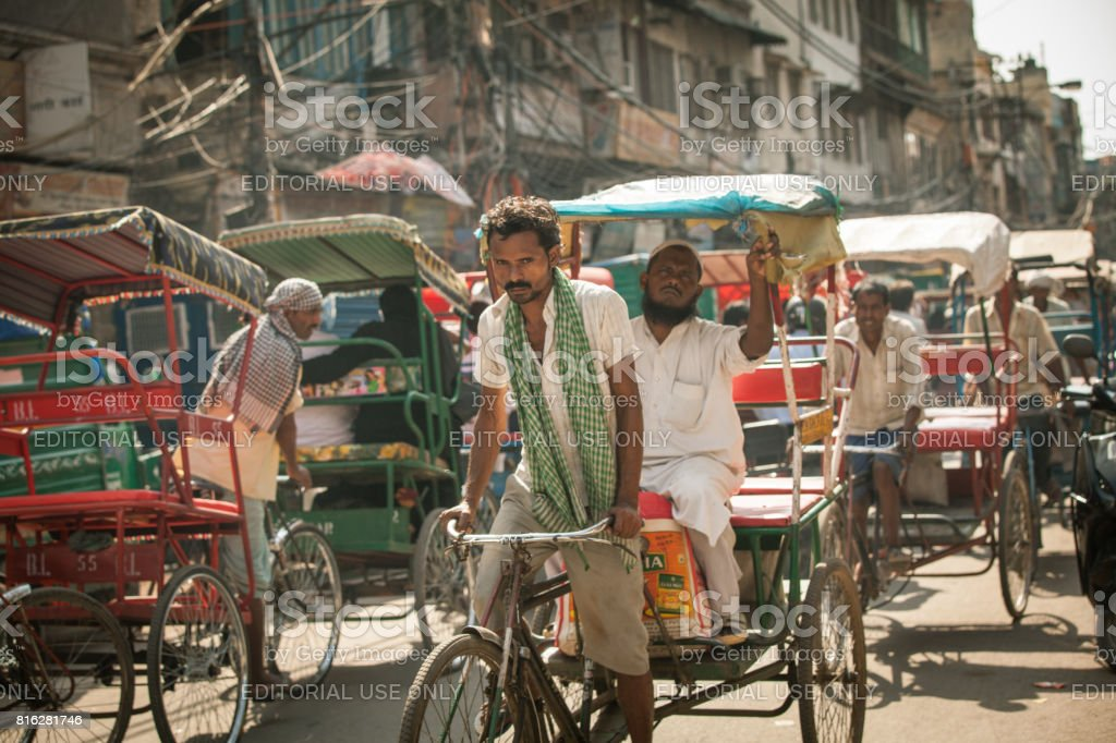 Cycle rickshaw on the street of Delhi, India stock photo