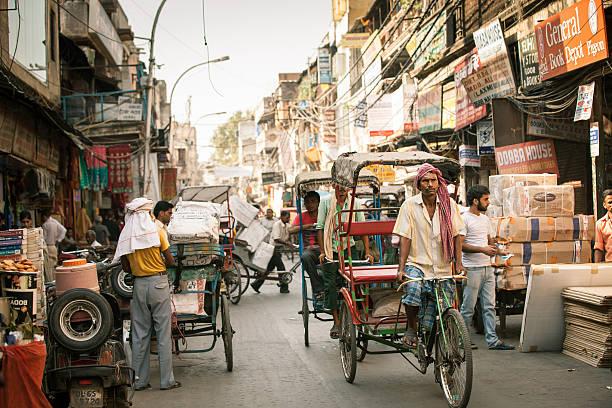 Cycle rickshaws on the street of Old Delhi, India stock photo