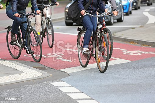cyclists on red cycle lane