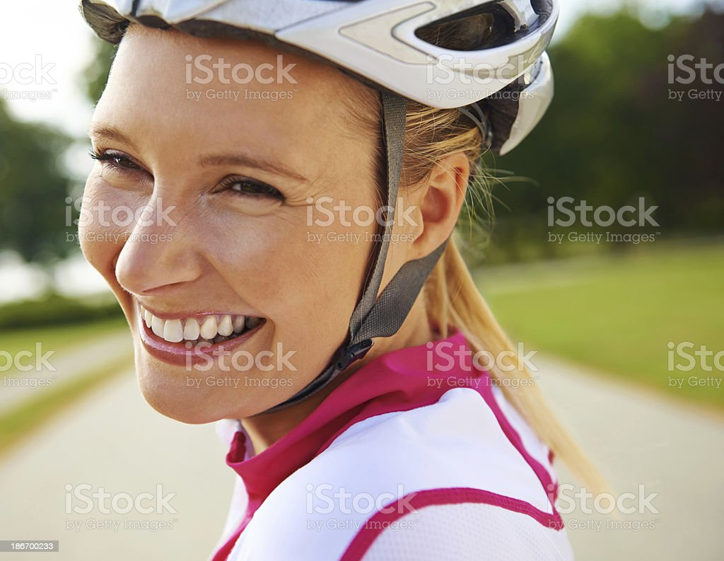 Cycling along a park road royalty-free stock photo