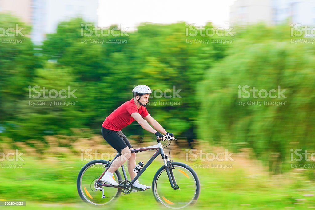 Cycling and Sport Concepts: Handsome Caucasian Rider Having a Bi stock photo