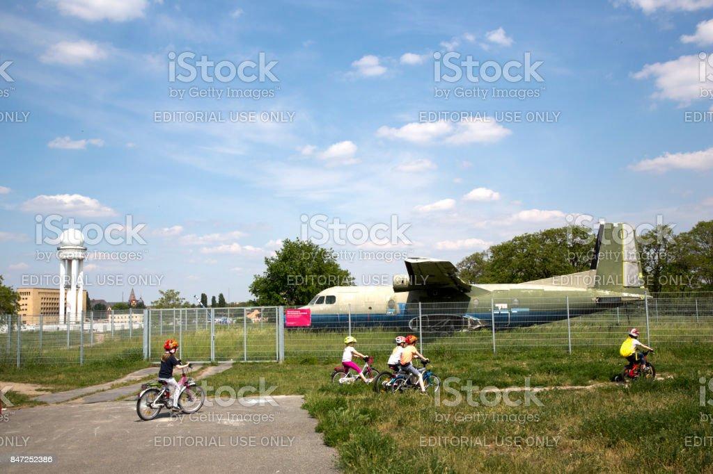 Cycling around abandoned airplane stock photo