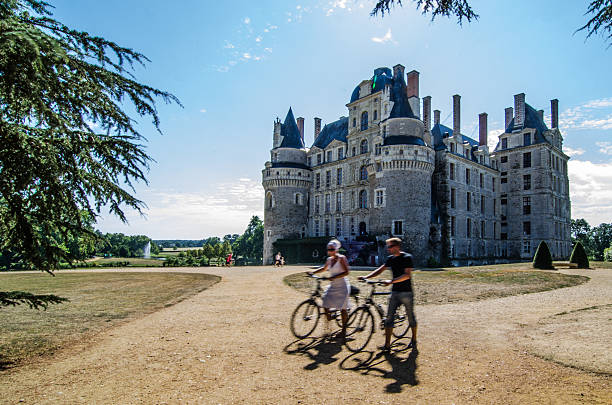 Cycling around the Brissac Castle in Loire,
