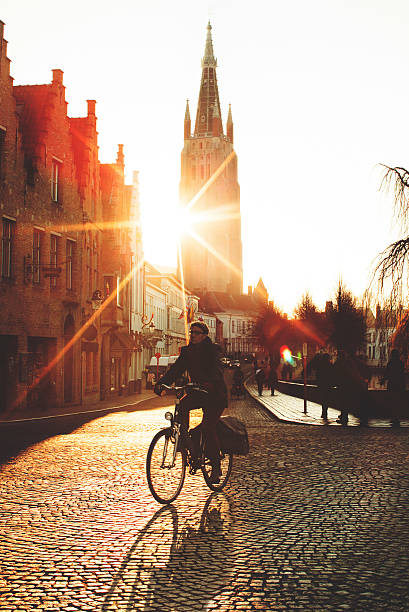 Cycling at sunset stock photo