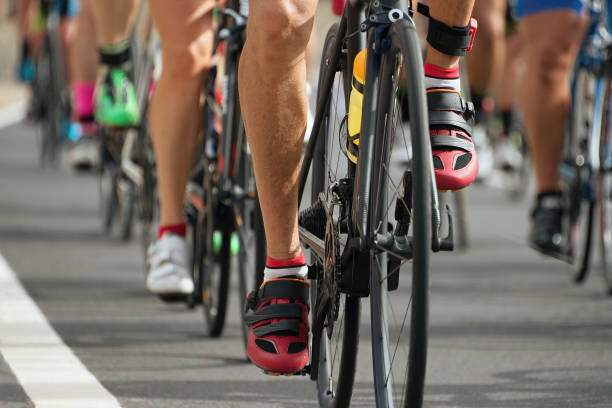 cycling competition,cyclist athletes riding a race - motorbike racing stock photos and pictures