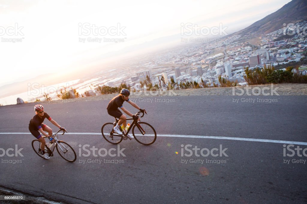 Cycling friends out riding stock photo