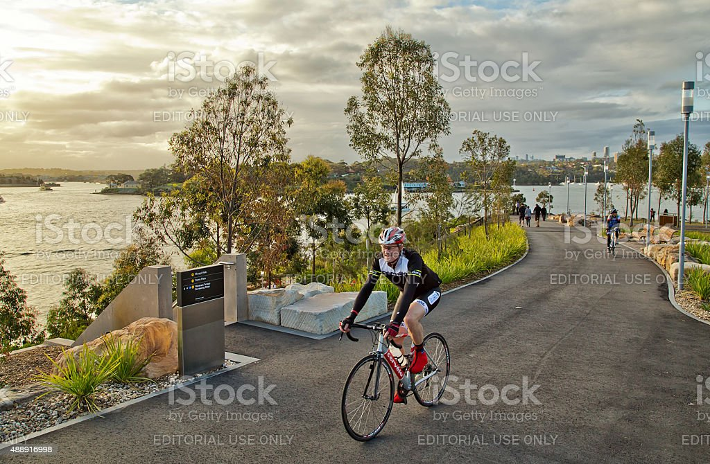 Cycling in Barangaroo Reserve - new parkland on Sydney Harbour stock photo