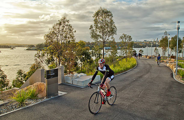 cycling in barangaroo reserve - new parkland on sydney harbour - barangaroo stock photos and pictures