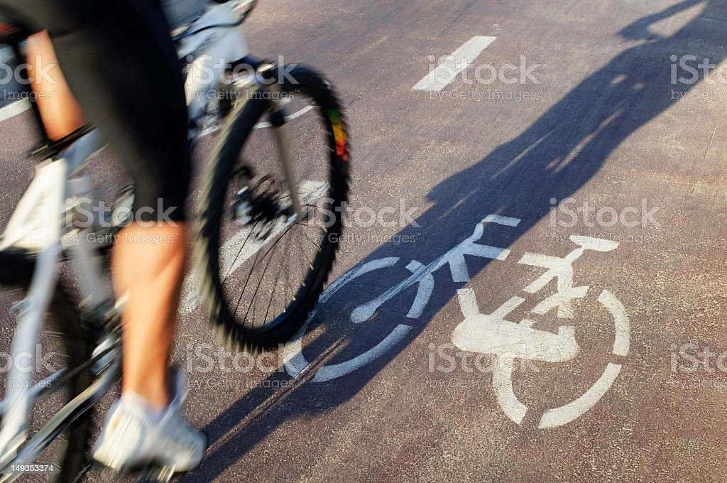 Cycling In Bike Lane royalty-free stock photo