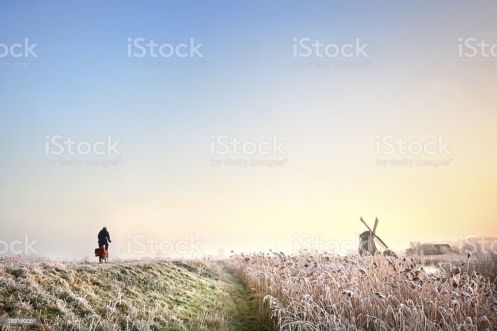 cycling in Holland cyclist in winterlandscape Bicycle Stock Photo
