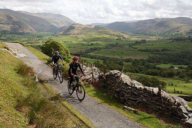 Cycling in the Lake District  cumbria stock pictures, royalty-free photos & images